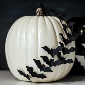 Bats Flying Across Pumpkin